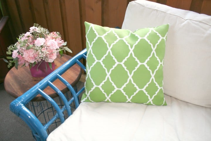 sunroom wicker couch pillow blue green