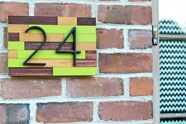 House number sign made from paint sticks