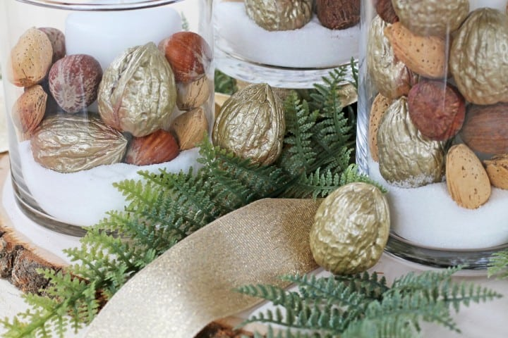 This is such an easy idea for holiday decorations and would come together so quickly! Definitely doing this with some Dollar Store candleholders and gold- painted nuts!