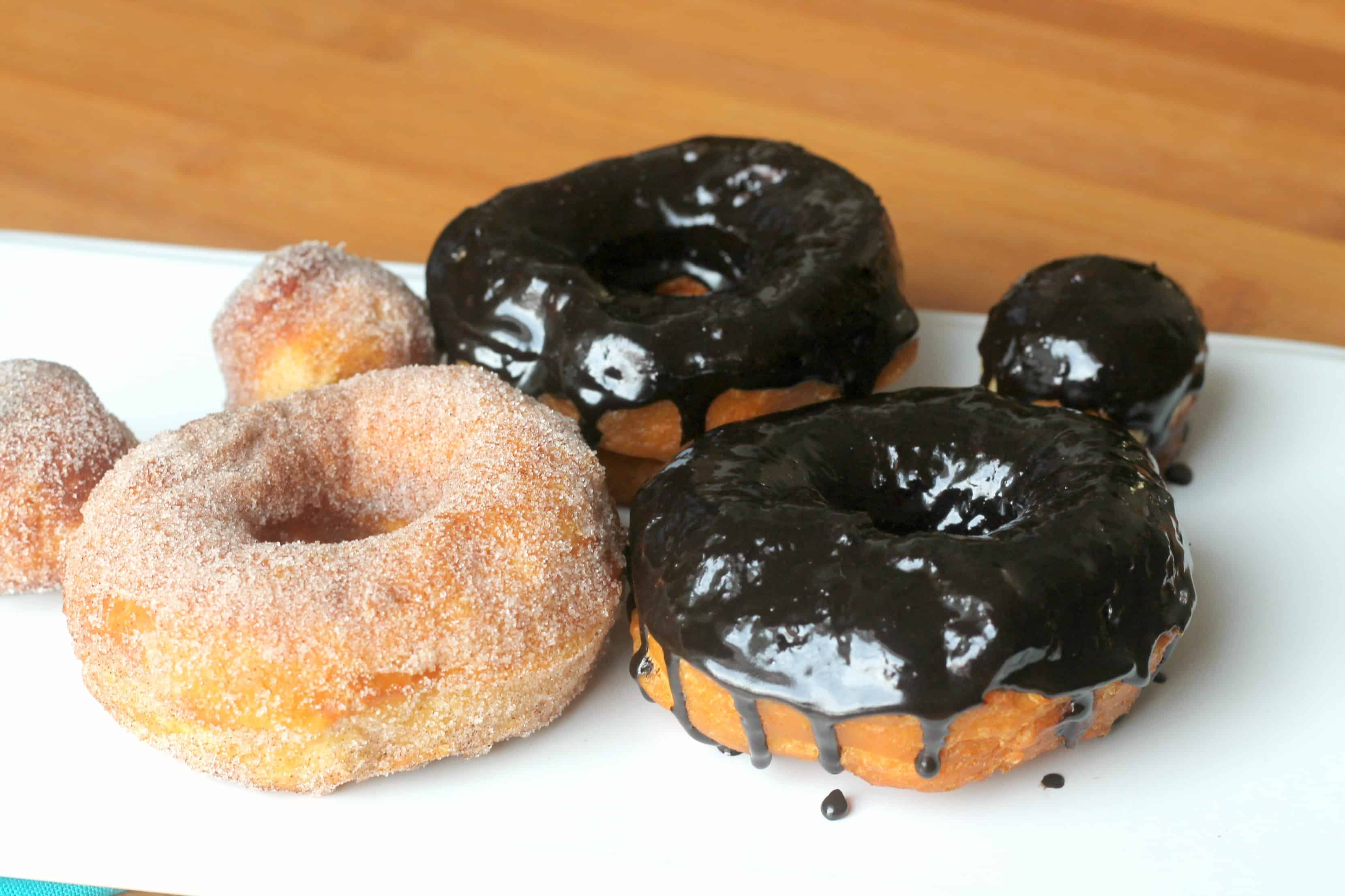 Biscuit donuts with cinnamon sugar and chocolate glaze