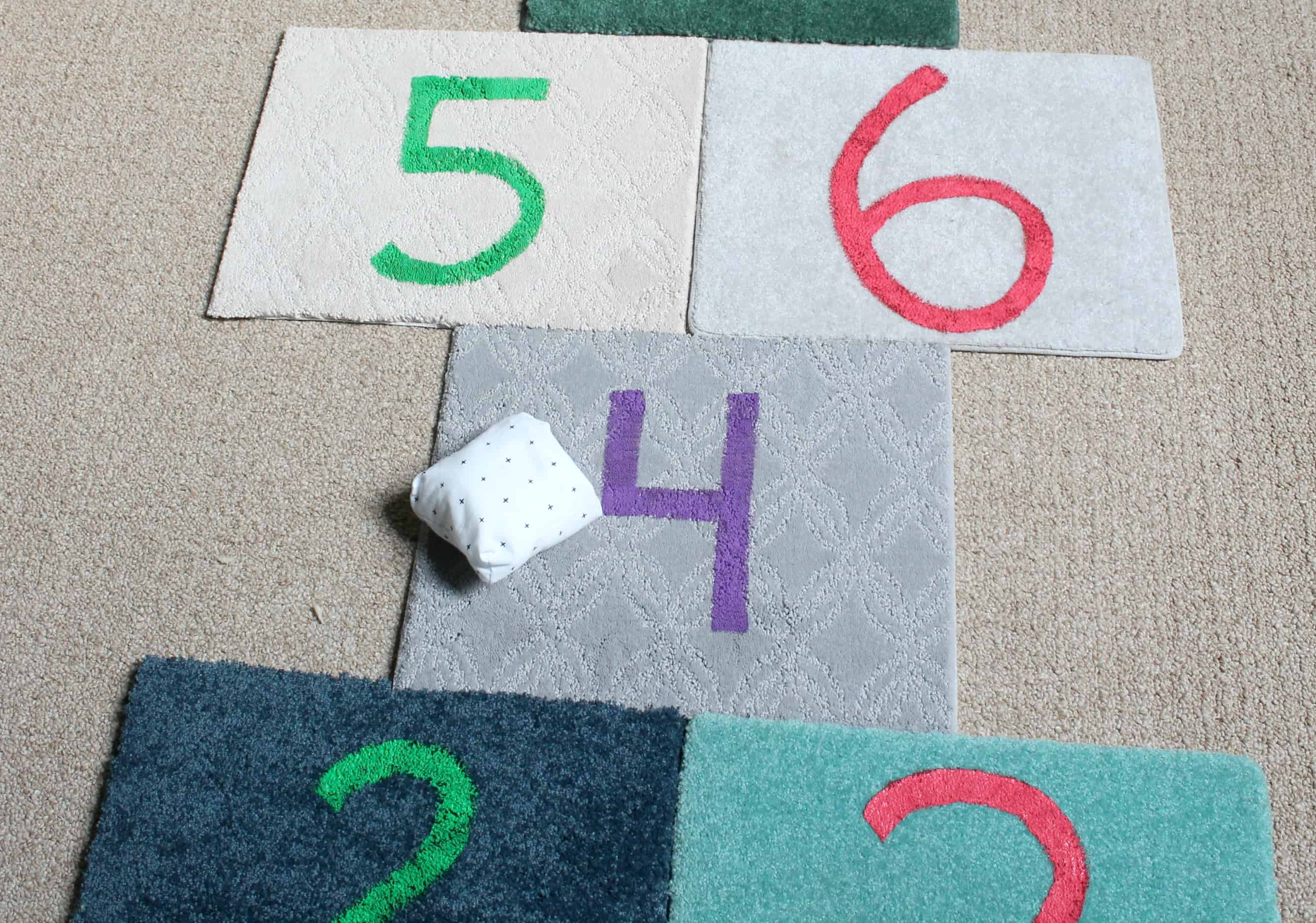 Make an indoor hopscotch set for your kids using $1 carpet tiles and craft paint!