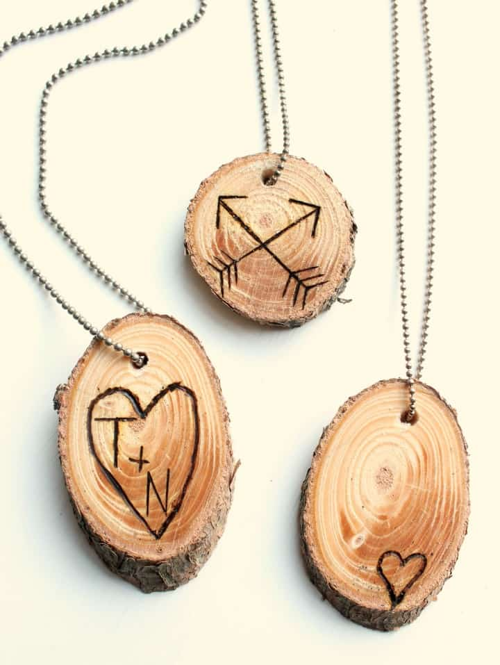 wood slice nekclaces with wood burning designs