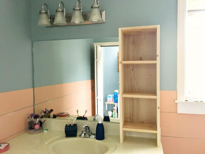 vanity unpainted shelf in bathroom