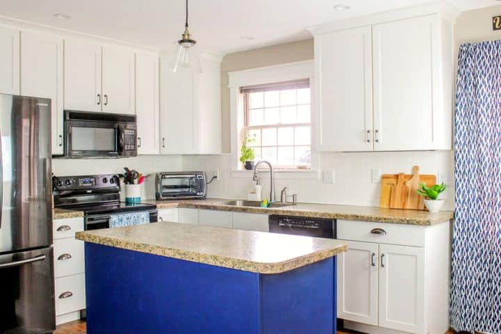 Modern Farmhouse Kitchen with white cabinets and navy accents