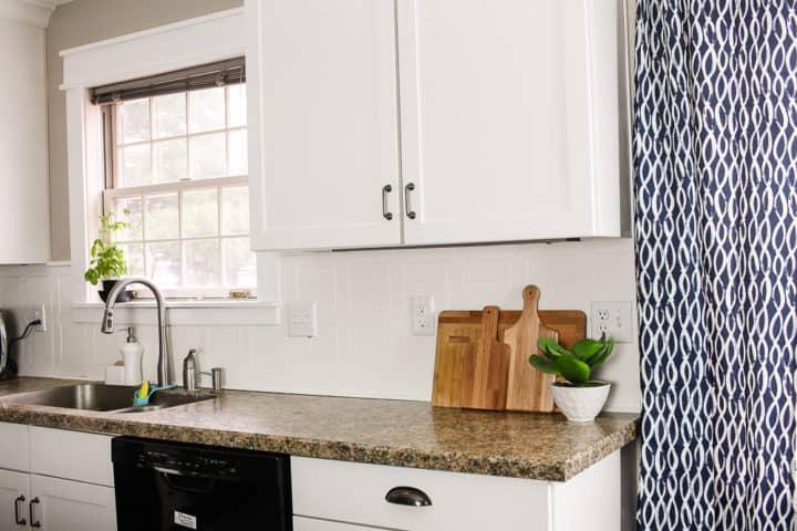 Modern Farmhouse kitchen with white tile backsplash