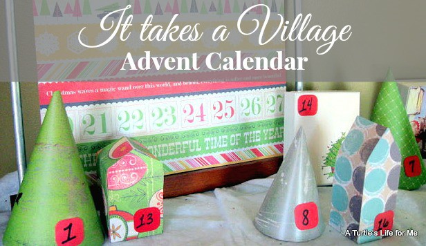 "A cover image for a blog post about making a random acts of kindness advent calendar. The image shows the homemade advent calendar village and the text says ""It Takes a Village Advent Calendar"""