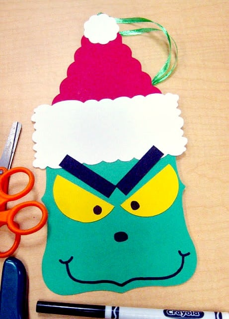 A Grinch  Christmas tree ornament made from scrapbook paper