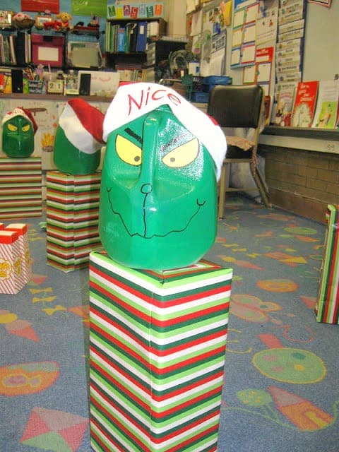 Tons of great ideas for a Grinch School party like this milk jug Minute to Win It game!