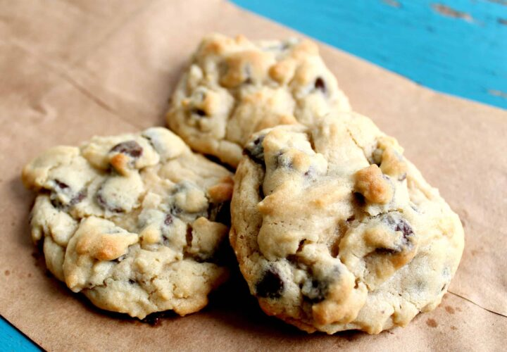 chocolate chip cookies with pudding mix stacked on a brown paper bag