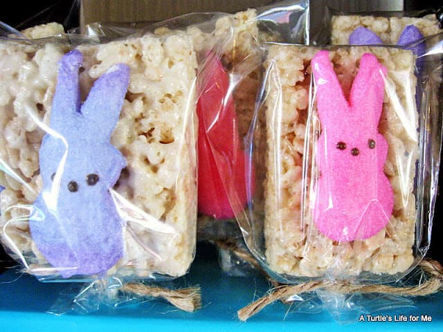 Homemade Rice Krispie Treats with Peeps Candies on them are wrapped in cellophane and displayed together as an Easter Peeps Treat