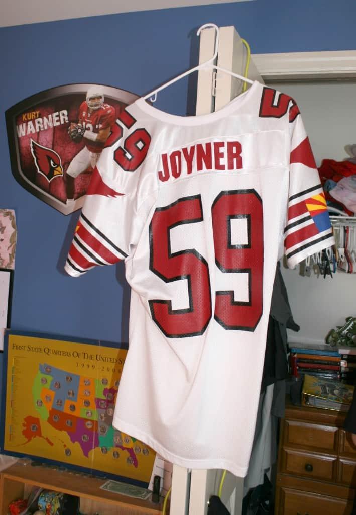 boys decorating sports jersey