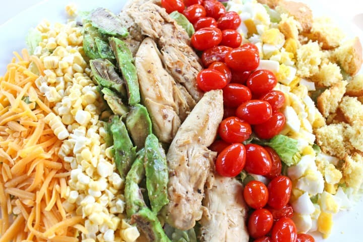 Grilled Chicken Cobb Salad with marinated avocadoes and tomatoes