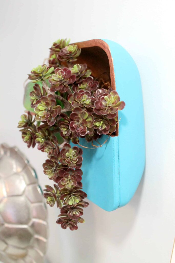 Use an old salad bowl from a thrift store to create this gorgeous succulent planter for the wall!
