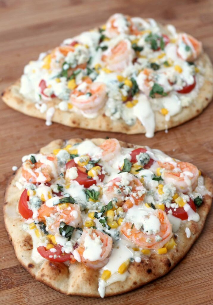 This grilled shrimp pizza with fresh veggies and bleu cheese dressing is amazing and so easy!