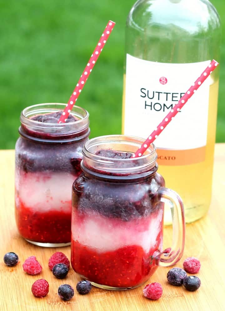 Red white and blue wine slushies with raspberries and blueberries! SO easy and perfect for 4th of July or other summer BBQs!