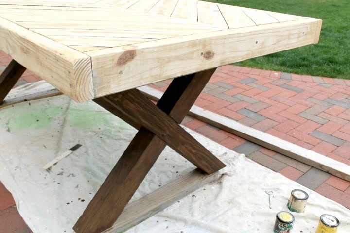 picnic table with two stains
