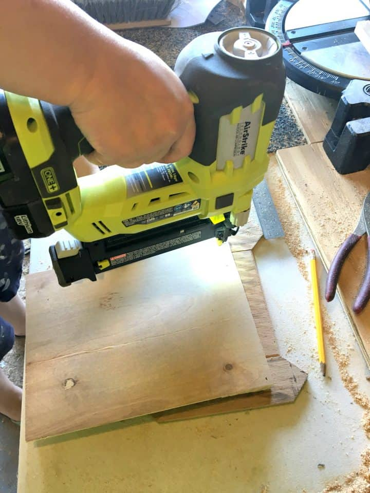 nailing-baseboard-to-wood