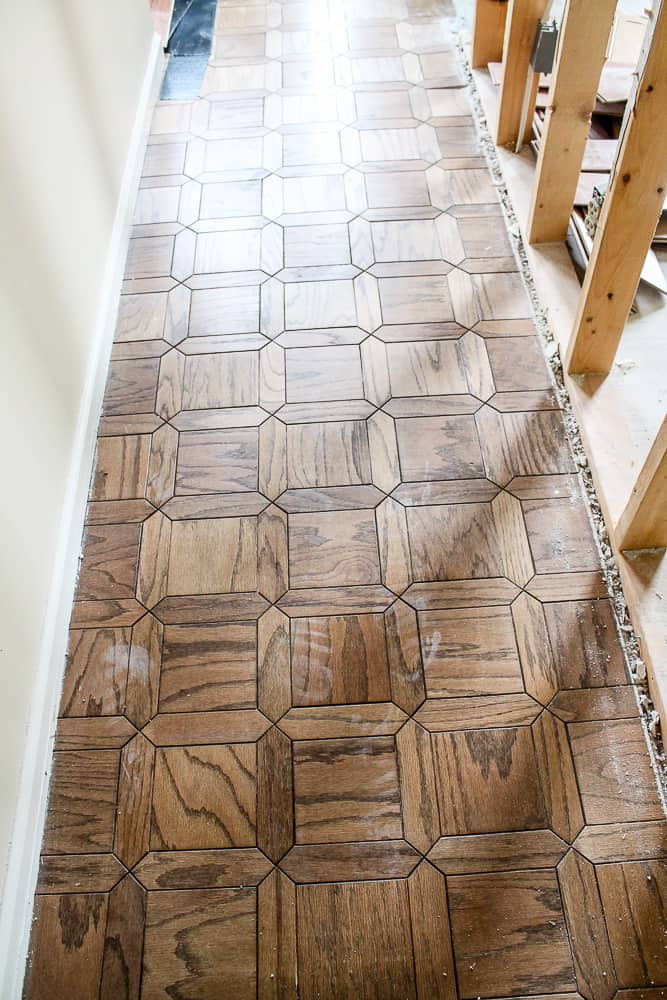 Parquet Floor tiles in a a hallway in the midst of a renovation