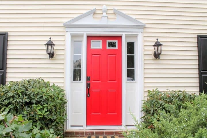after yellow siding house with red door_