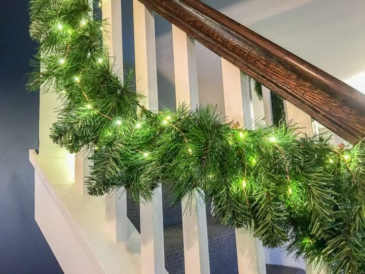 faux evergreen stair garlands with lights