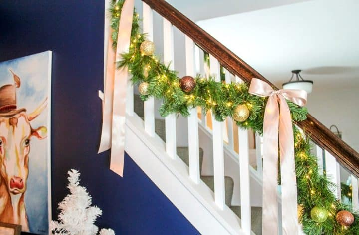 how to make faux evergreen stair garlands with LED light