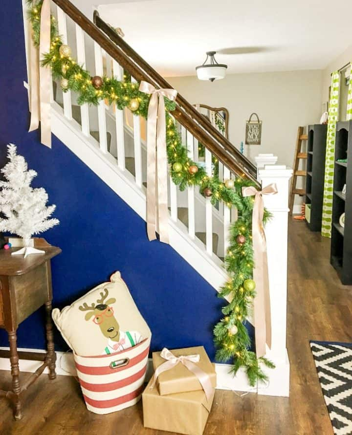how to make faux evergreen staircase garland with LED Christmas lights