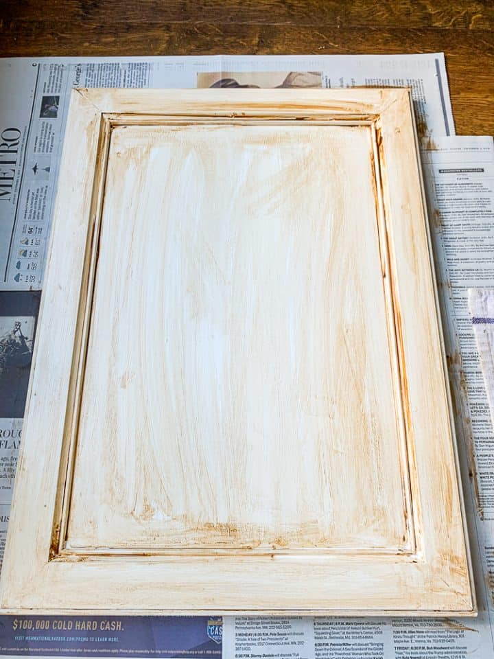 Cabinet door painted with stain to age it