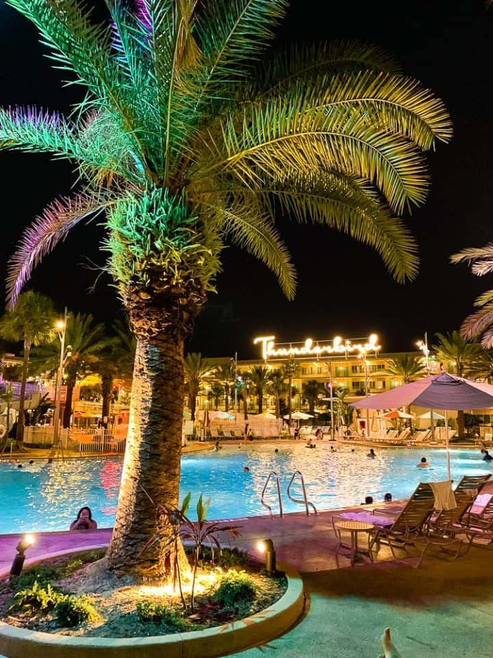 Cabana Bay Beach Resort pool at night time with a palm tree
