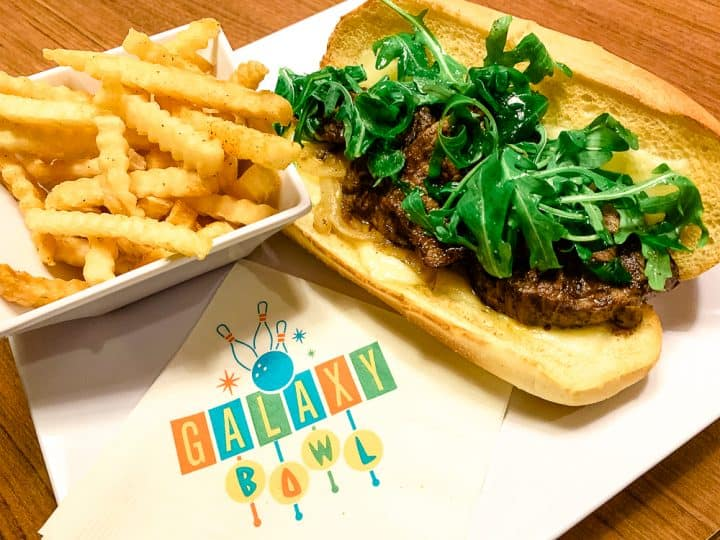 steak sandwich and fries with Galaxy Bowl napkin from Cabana Bay Beach Resort
