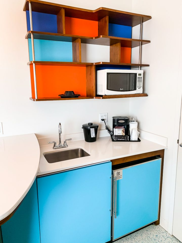 kitchenette in retro colors inside a Cabana Bay Beach Resort family suite