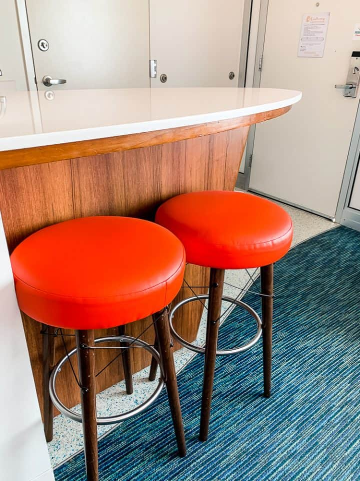 surfboard counter top with orange stools