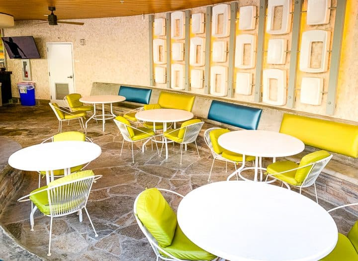 retro green and blue chairs and tables at the Cabana Bay Beach Resort