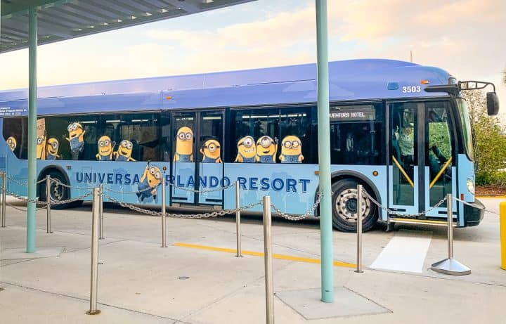 blue Universal shuttle bus with minions on it
