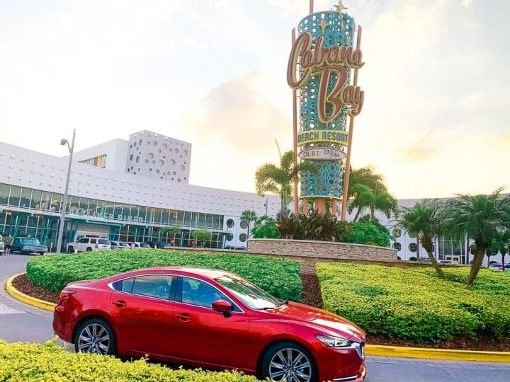 Cabana Bay Beach Resort at Universal with red Mazda6 signature car parked in front