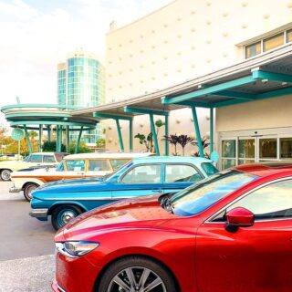 red Mazda 6 Signature car with retro cars at hotel resort