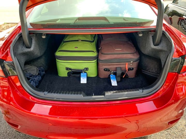 trunk space on the red Mazda6 signature series car with suitcases in the back