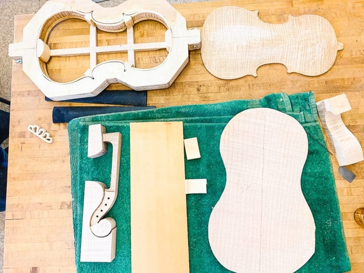all the different wooden pieces that go into making a violin