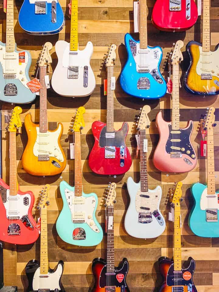 wall of colorful electric guitars at the Guitar Spot USA in York PA