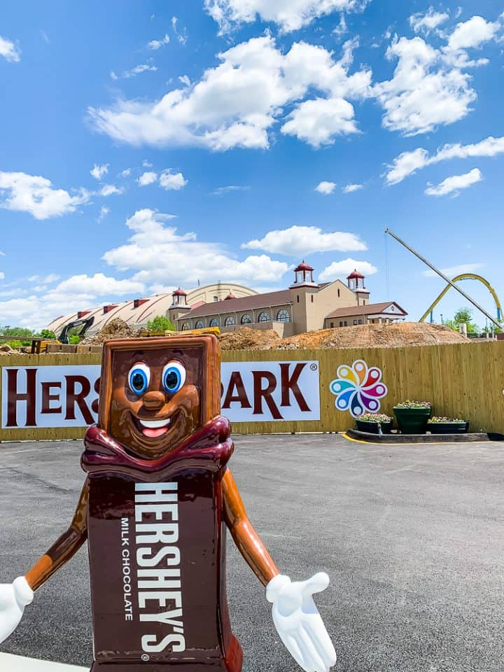 Hershey chocolate bar height requirement statue with construction behind it