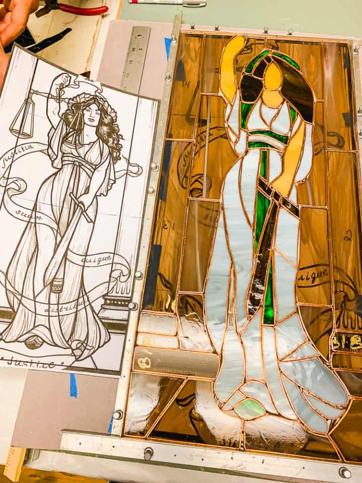 Stained glass piece of art of a greek goddess