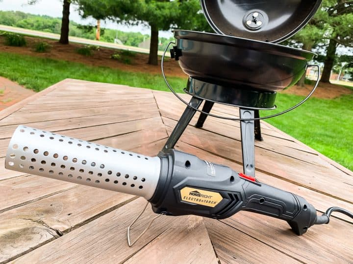 charcoal grill with HomeRight Electro Torch in front of it