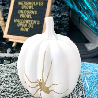 white ceramic pumpkin with gold vinyl spider