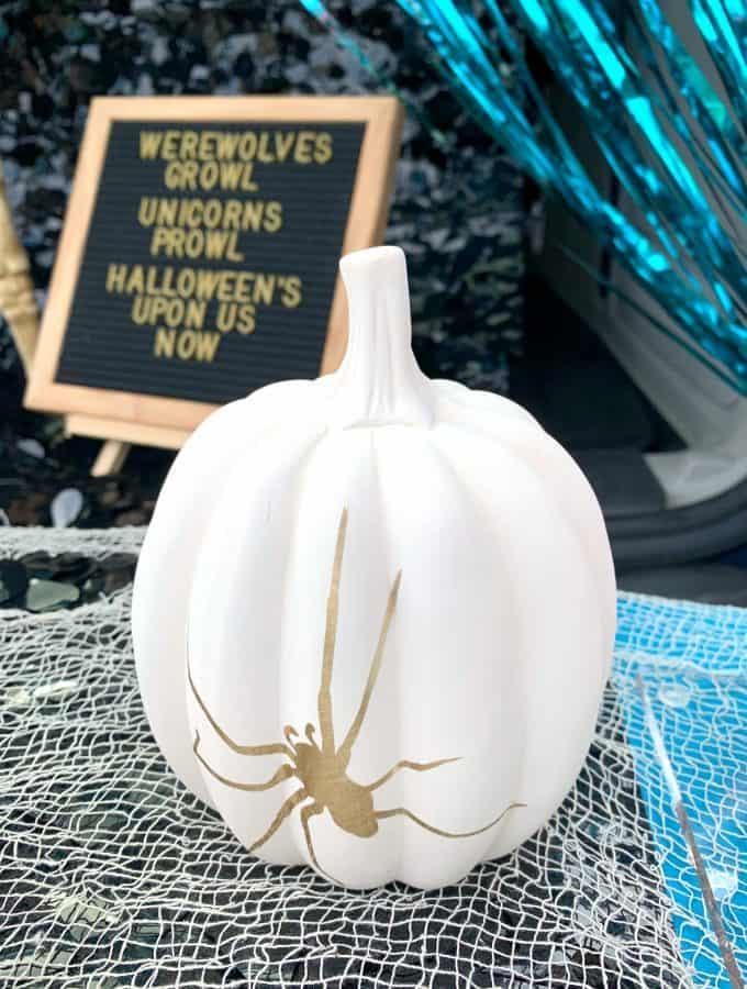 white ceramic pumpkin with gold vinyl spider
