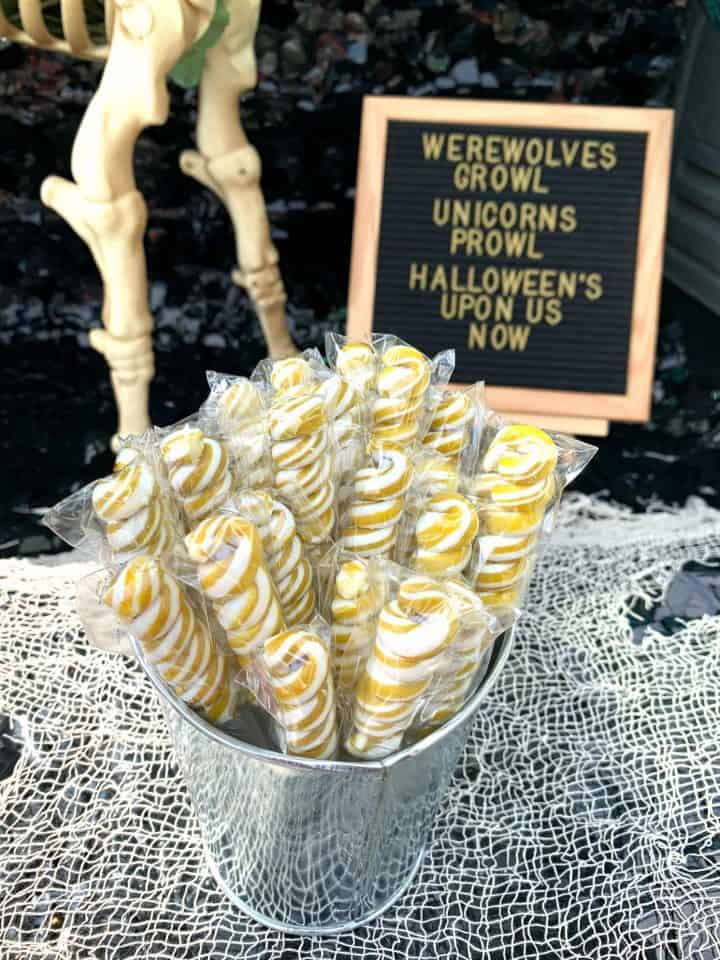 gold and white swirl lollipops for unicorn party favors