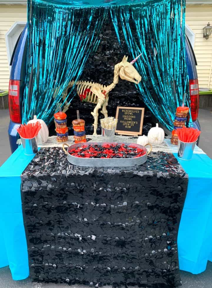 trunk or treat with unicorn and black and teal decorations