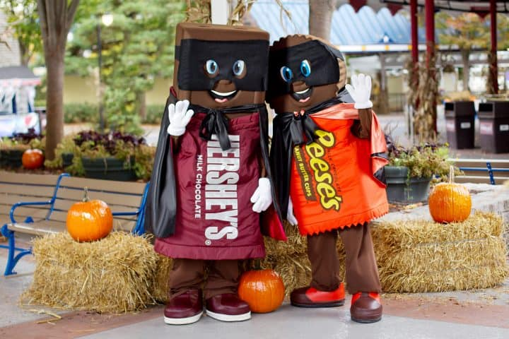 Hershey Bar and Reese's Cup costume characters dressed up for Hersheypark in the Dark