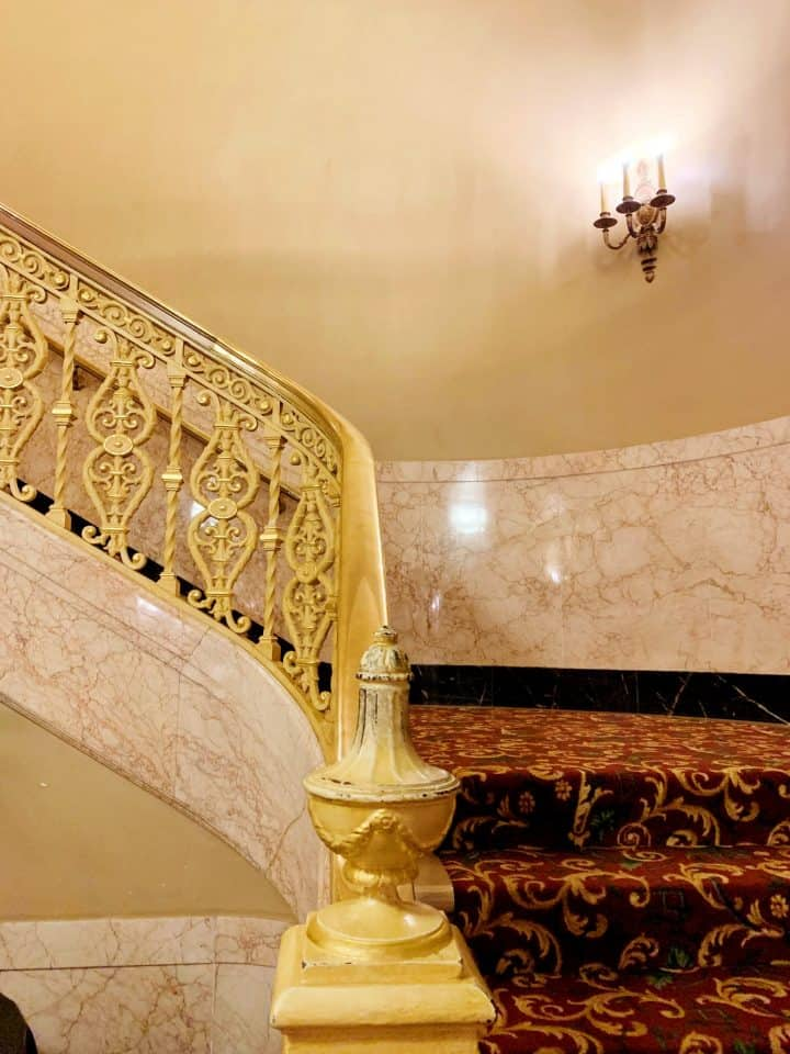gold curved staircase at the hershey Theatre