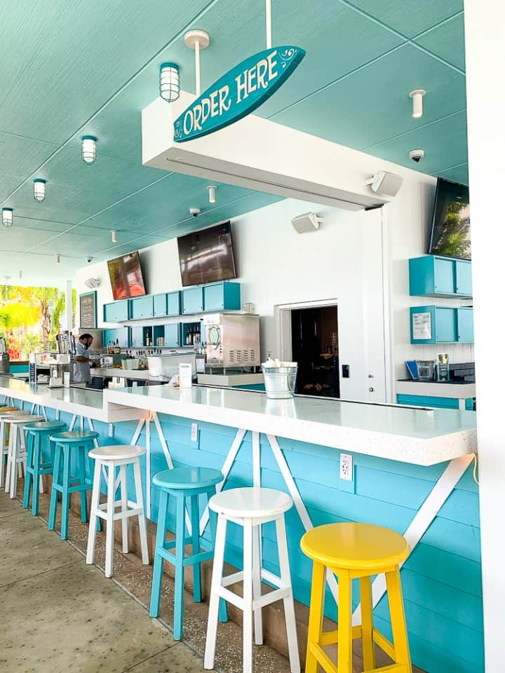poolside bar with colorful stools at Surfside Inn and Suites in Orlando