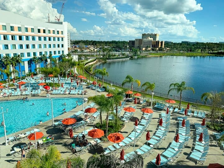 view of hotel pool and lake from room of Universal's Endless Summer Resort