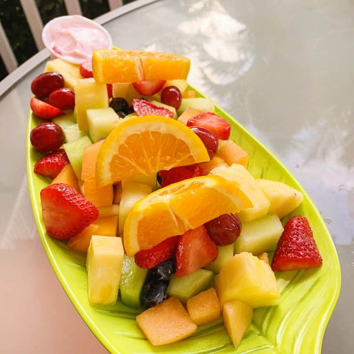 fresh fruit platter on green plate
